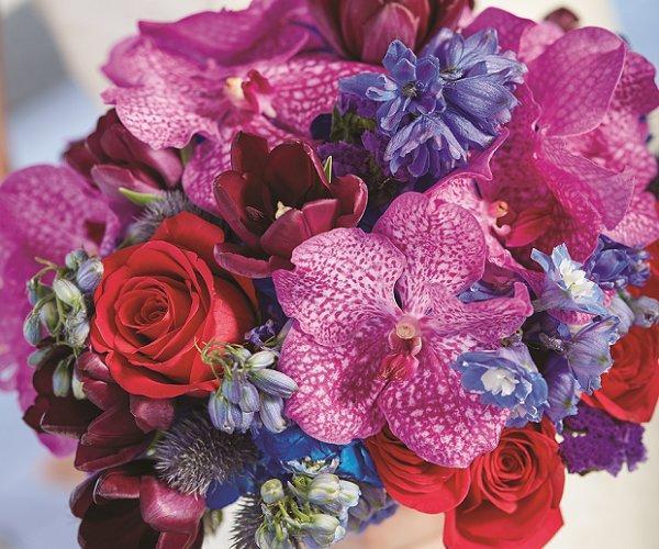 Aruba Wedding Bouquet by Shar Chatram flowershop: Magenta Orchids, Red Roses, Burgundy Tulips, Violet Delphiniums, Lavender Statice, Steel Blue Eryngium